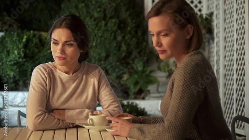 Two sad ladies sitting outdoors after quarrel, communication problem, conflict Canvas-taulu