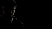 Terrorist Spy With Headphones Looking Suspiciously At Camera, Data Leak Risk