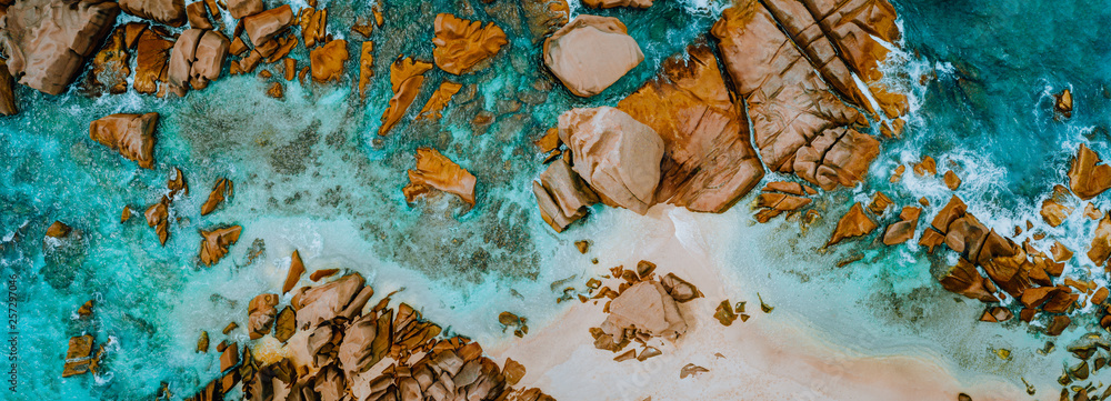 Fototapety, obrazy: Aerial top panorama view of ocean shore huge bizarre granite rocks boulders on tropical beach with turquoise azure water. Amazing rock cliff seascape and coastline Seychelles La Digue Island