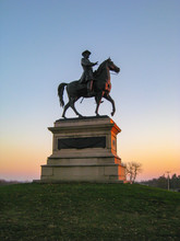 Gorgeous Sunset Silhouetting The Statue Of Union Major General Winfield Scott Hancock At Gettysburg National Park In Pennsylvania (USA).