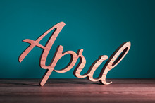 Hello April Wooden Texe Written On Dark Background. Spring Time Concept