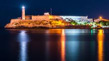 Havana, Cuba. Lighthouse And Morro Castle Mirroring In The Caribbean Sea.