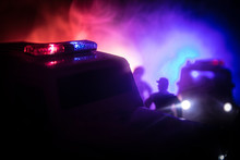 Police Car Chasing A Car At Ni...