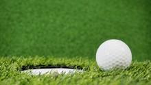 Golf Ball Near The Hole Or Pin