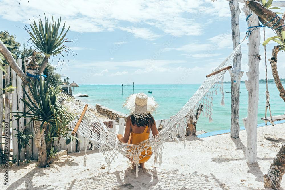 Fototapety, obrazy: Girl relaxing in hammock in tropical beach cafe