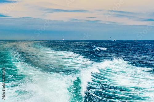 Sea water foam Ship track in the ocean Water texture. Ocean view Marine travel Cape cod Massachusetts
