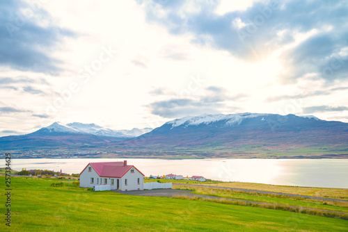 Beautiful rural view traditional house small village in Svalbardseyri near Akureyri, Iceland