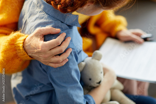 Canvas-taulu Closeup of unrecognizable woman hugging teenage girl with care and love, copy sp