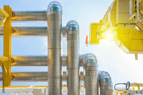 Fotografie, Obraz Oil and gas process pipeline with stainless steel insulation for keep temperature inside pipe stable and protect environment impact
