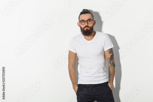 Fotografie, Obraz  hipster, people concept - Tattooed bearded man in white shirt isolated on white