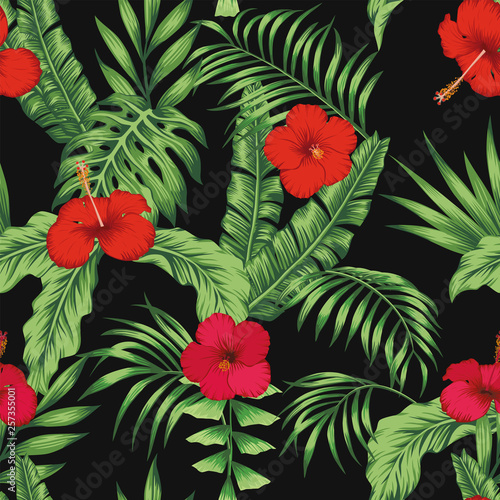Tropical pattern leaves flowers seamless black background