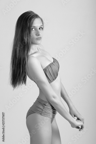 bb7337e03f2b9 Slim body of young woman in bikini on white . Girl with healthy sporty  figure
