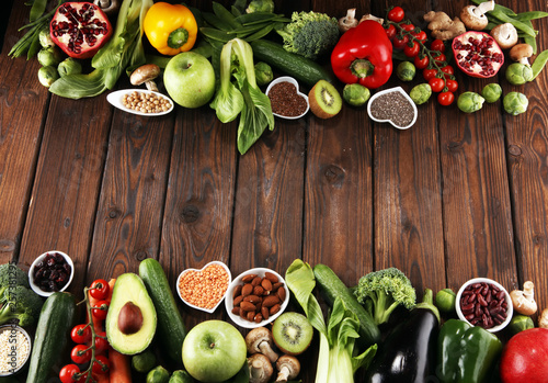 Healthy food clean eating selection. fruit, vegetable, seeds, superfood, cereals, leaf vegetable on rustic background - 257381295