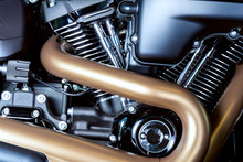Motorcycle Internal Combustion Engine With Air Cooling, Close-up, Detail, Macro. Engine Parts, Cylinder Head, Ignition, Exhaust Pipe, Air-intake Manifold