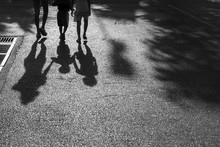 The Shadow Of A Family On The Street.
