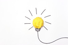 """Creative Concept """"idea"""", A New Idea. Painted Light Bulb With A Crumpled Paper Yellow Ball."""