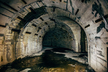 Long Underground Tunnel Or Corridor In Abandoned Soviet Military Bunker Or Basement Or Shelter With Creepy Atmosphere. Inside Concrete Industrial Construction