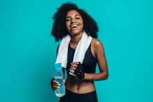 Healthy Woman Taking A Break After Exercising