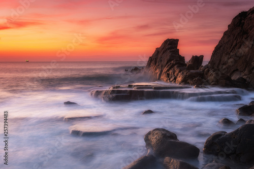 Poster Lavender amazing sunset landscape at rocky beach