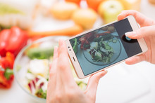 Food Blogger Taking Mobile Photo Of Prepared Meal. Online Cooking Recipes And Healthy Lifestyle