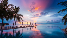 Beautiful Poolside And Sunset Sky. Luxurious Tropical Beach Landscape, Deck Chairs And Loungers And Water Reflection