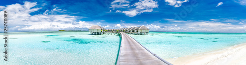 Panoramic landscape of Maldives beach. Tropical panorama, luxury water villa resort with wooden pier or jetty. Luxury travel destination background for summer holiday and vacation concept. - 257411089