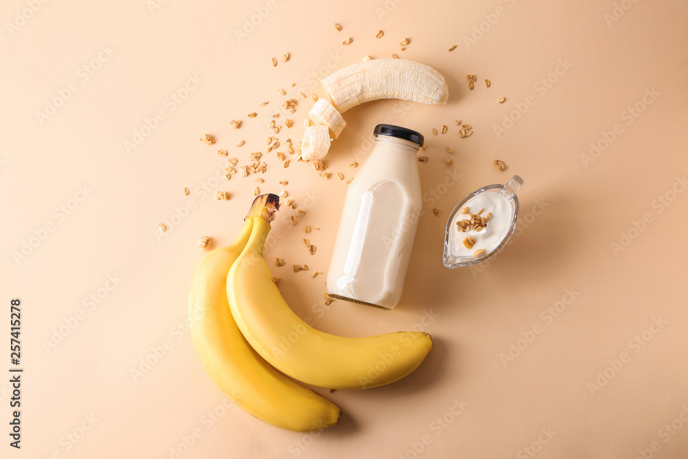 Fotografie, Obraz Composition with bottle of banana smoothie on color background