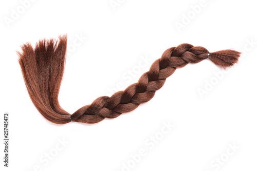 Obraz Braided strand on white background. Concept of hair donation - fototapety do salonu