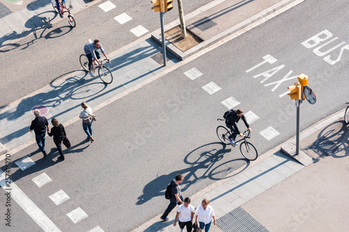Obraz na plátne People crossing street Cycling and Walking Traffic sign Smart city Urban lifesty