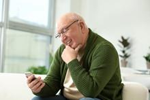 Senior Man With Hearing Aid Us...