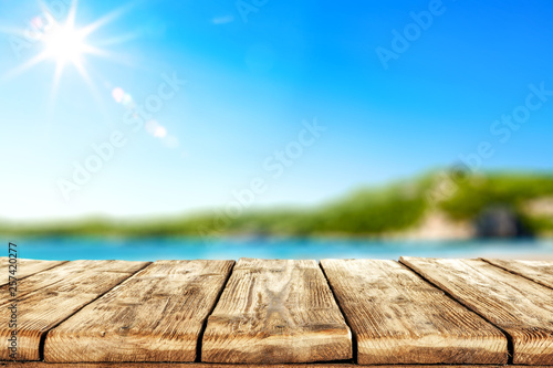 Foto auf Leinwand Beige Desk of free space and summer sea landscape