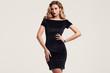 canvas print picture - Gorgeous elegant sensual blonde woman wearing fashion black dress