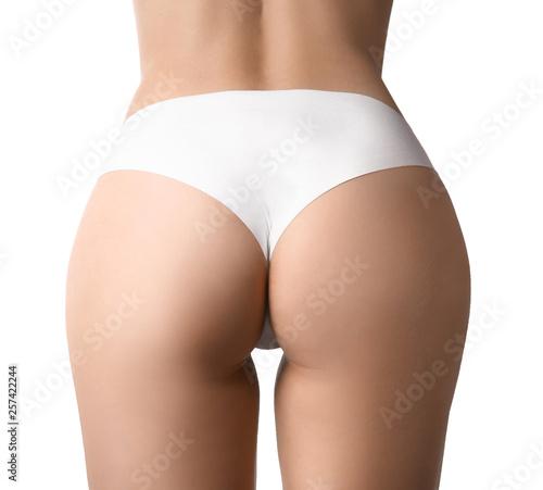 Obraz na plátně Buttocks of beautiful young woman on white background