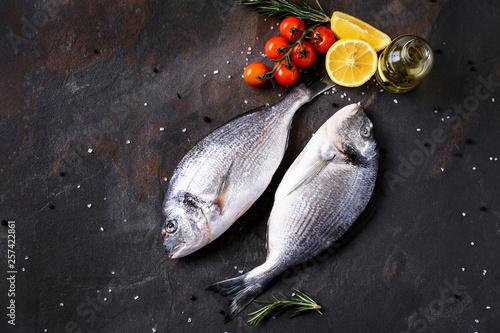 Fotografie, Obraz Fresh fish, tomato and lemon on table