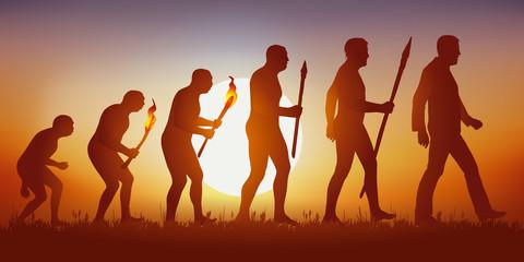 Concept de la théorie de l'évolution de Darwin, illustré avec la transformation de la silhouette humaine, de homme primitif à l'homme moderne.