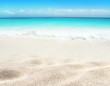 Tropical white sandy beach and blue sea blurred background.
