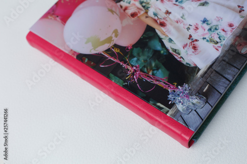 pink photobook on a white background Fototapeta
