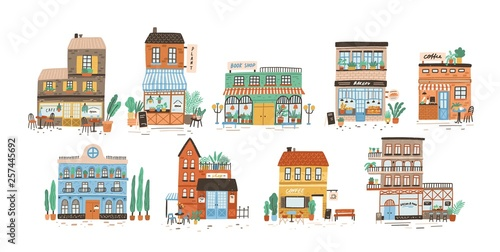 Fototapeta Collection of stores, shops, cafe, restaurant, bakery, coffee house isolated on white background. Bundle of buildings on street of European city. Flat vector illustration in cute naive style. obraz