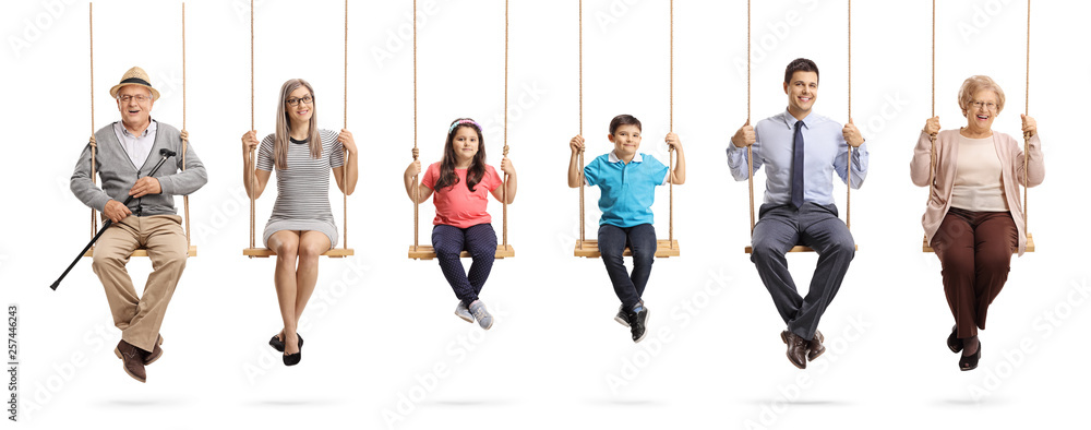 Fototapety, obrazy: Grandparents, parents and children sitting on swings and smiling at the camera