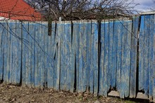 Part Of Blue Wooden Old Fence On Rural Street