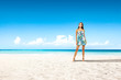Slim young woman on beach and sea landscape