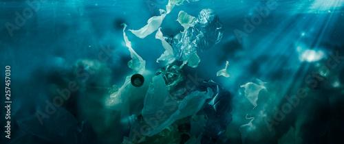 Fotografie, Obraz  Toxic plastic waste floating underwater in the ocean