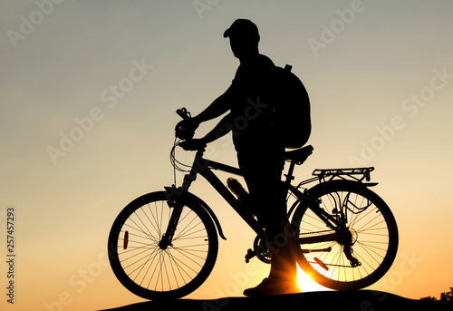 Aluminium Prints Cycling Concept of healthy lifestyle. Silhouette of cyclists at sunset
