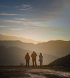 3 friends watching the sunset on mountain top