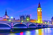 canvas print picture - View of the Houses of Parliament and Westminster Bridge along River Thames in London at night.
