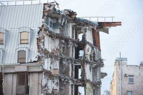 Fotografía Destroyed building after demolition, man-made accident