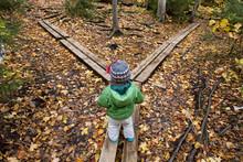A Young Girl Walks Across Hiki...