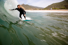 Surfer Does A Bottom Turn Whil...