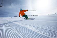 A Male Alpine Skier Smiles Whi...