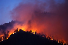 A Forrest Fire Burning The Side Of A Mountain In East Missoula, Montana.
